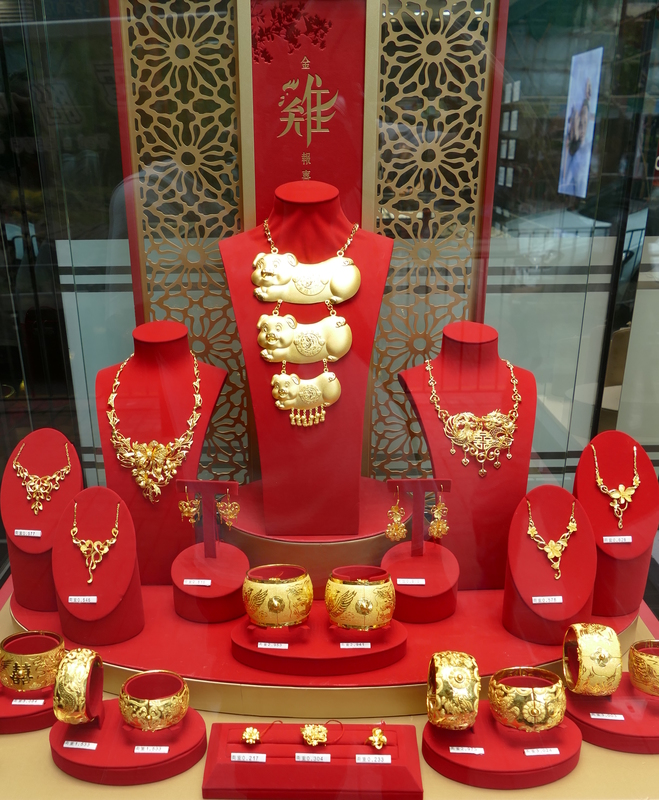 A jewelry display window, including one of the largest gold necklaces ever made by man, featuring three happy pigs*