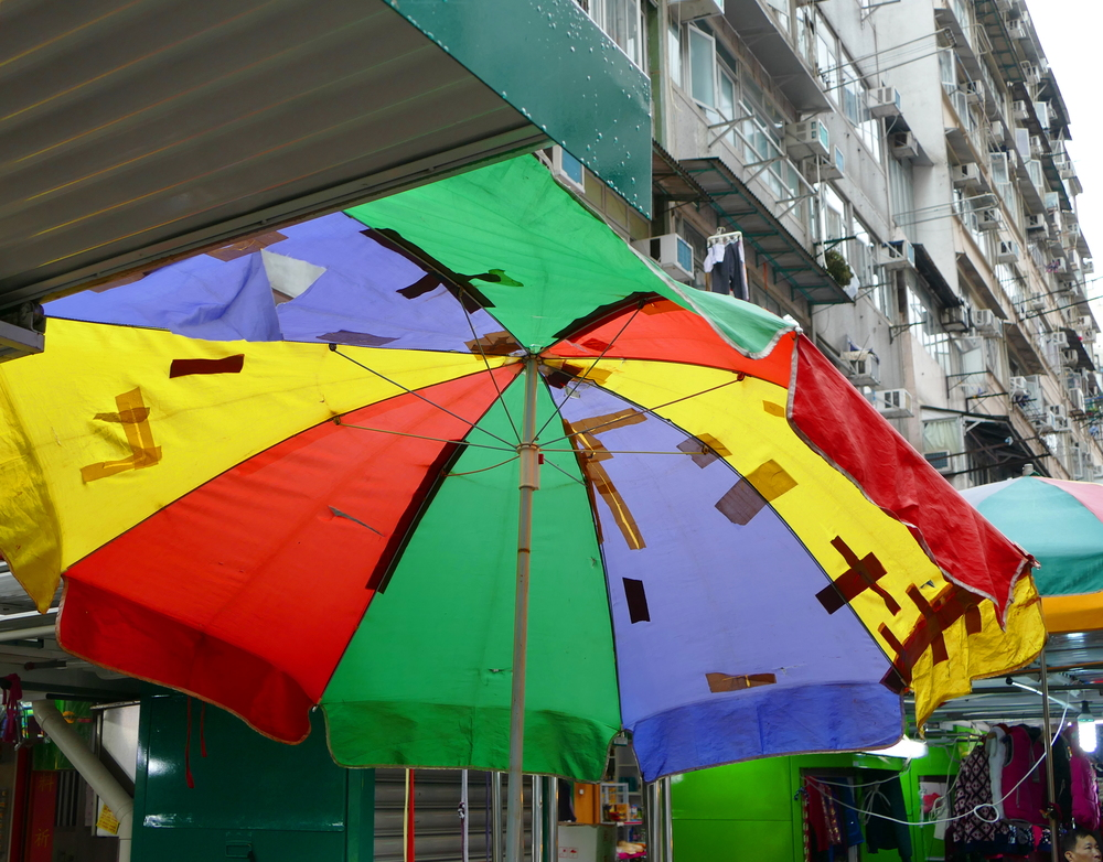 A colourful umbrella patched with tape