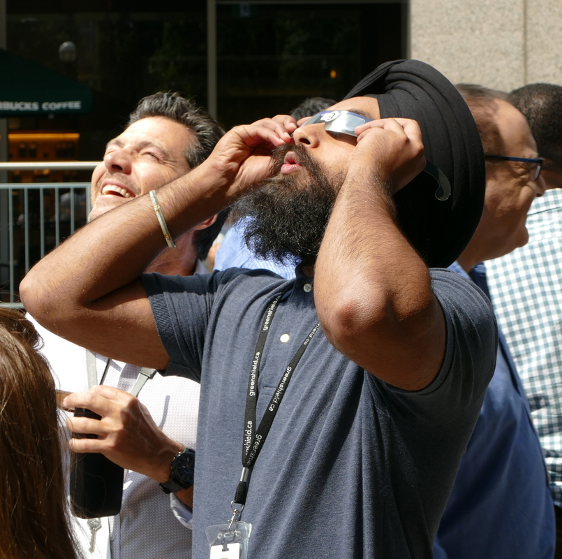 Man watching the eclipse.