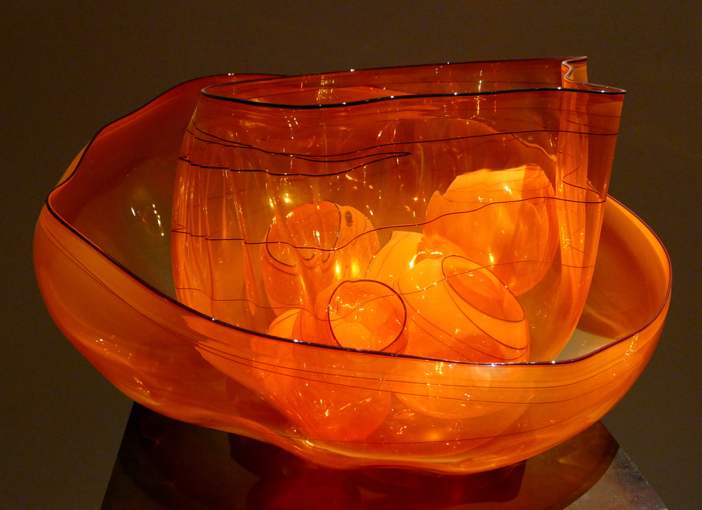Chihuly - orange glass bowls within glass bowls