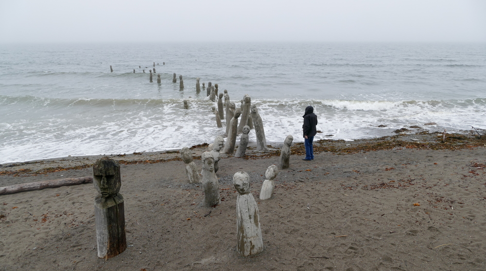 stone and wood figures emerging from the St. Lawrence onto the beach