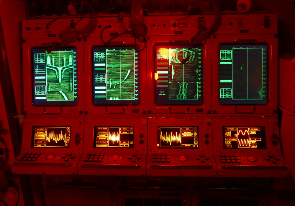 red lighting and big green CRT displays