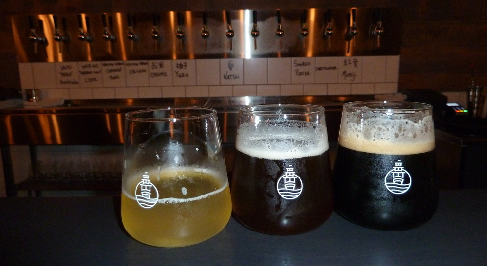 light, brown, and opaque beers with the taps behind