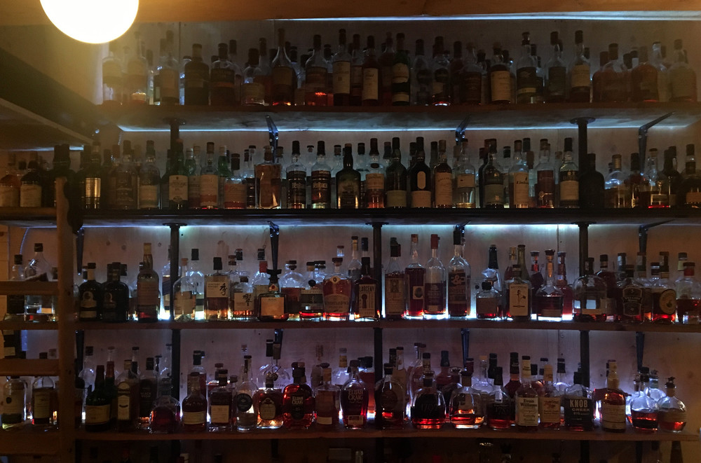 About 100 whisky bottles behind the bar at Folly
