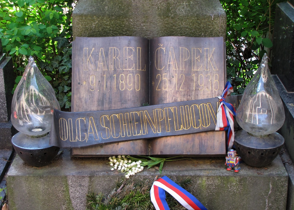 Karel Čapek's grave with red-white-and-blue ribbons and a small tin robot
