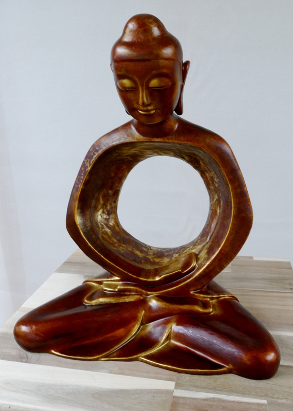 A modern, almost traditional Buddha sculpture - but the torso is entirely empty.