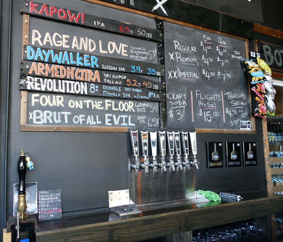 Eight taps, of which seven were active.  Hand-labeled names on a chalkboard.