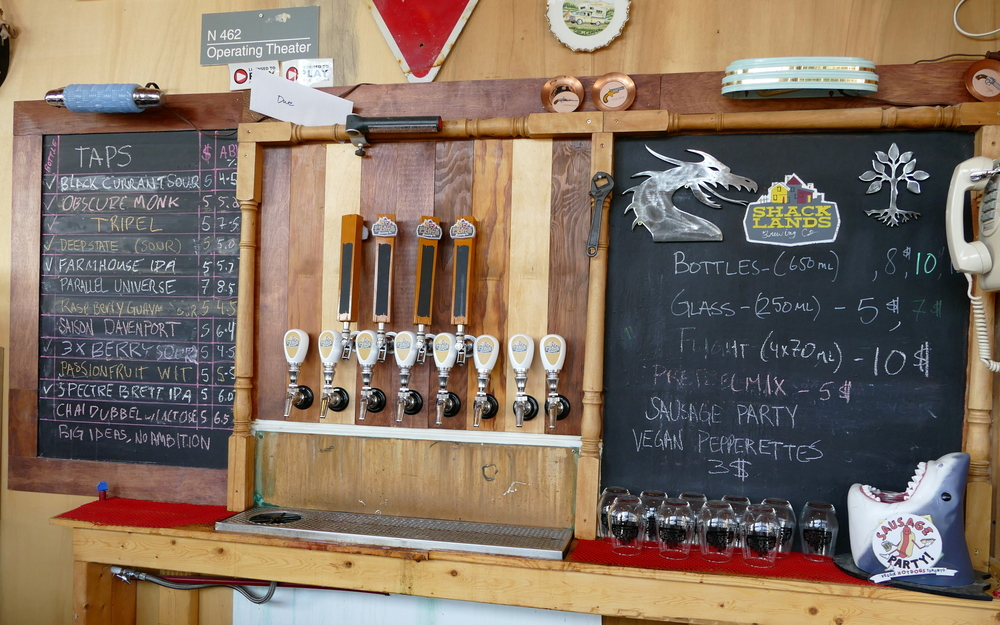 twelve taps plus a couple chockboards listing the available brews