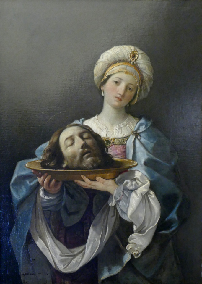 a rather unhappy girl holding a head on a platter