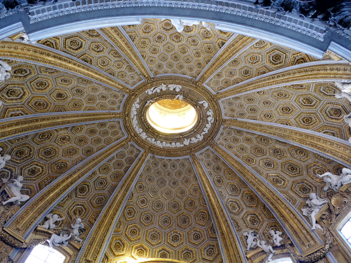 oval ceiling with hexagons, a huge amount of gold leaf, and lots of plaster cherubs