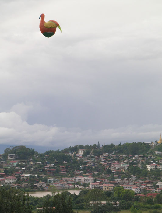 a bird-shaped balloon (the size of a small house) floating over Taunggyi, Myanmar