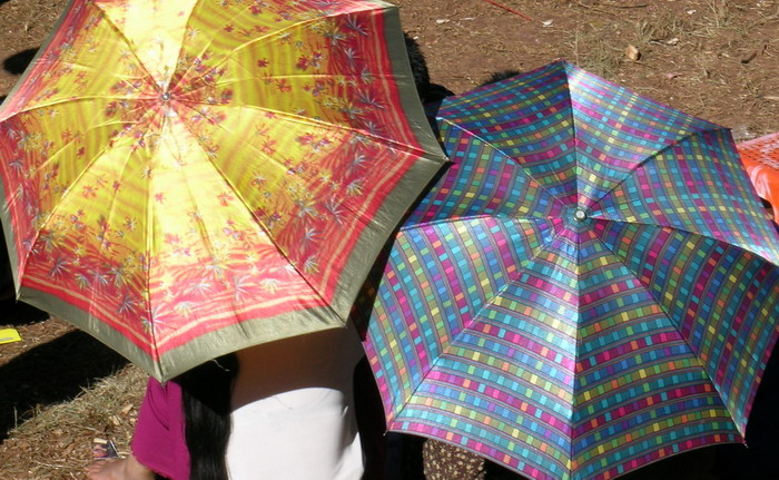 Two colourful umbrellas