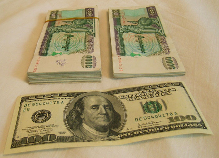 A single $100 U.S. bill and the 125 x 1000 kyat bills it buys you in Myanmar