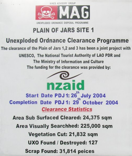 """Unexploded Ordnance Clearance Programme"" signage: essentially ""follow the marked path at the Plain of Jars or be exploded."""