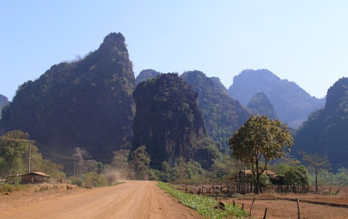 Dirt road with looming karsts.