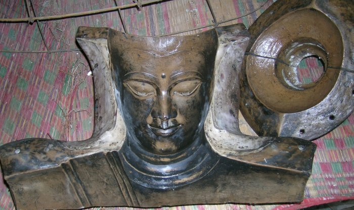 Casting casing for making Buddha images, showing the face.