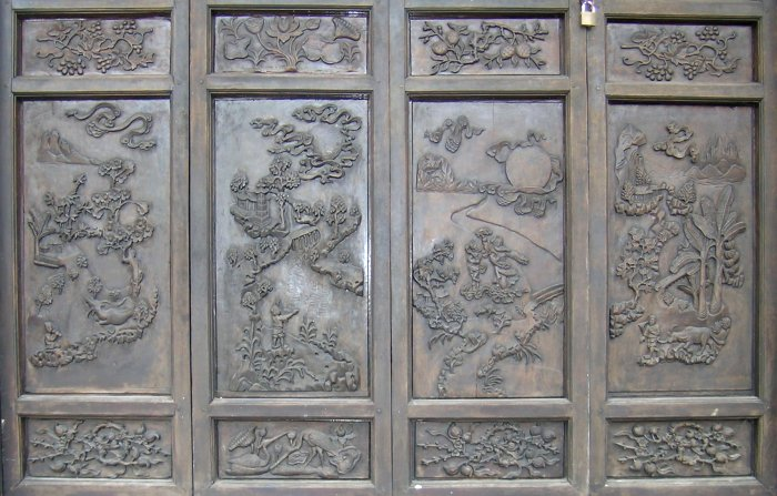 Door carvings at a temple near the Perfume Pagoda.