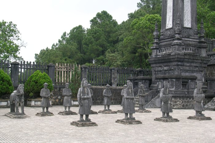 A number of stone men and a horse stand guard outside the emperor's tomb