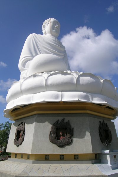 Huge white seated Buddha against the sky
