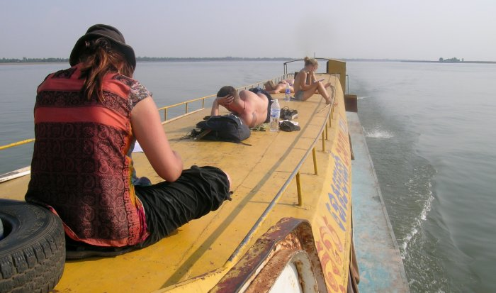 Sitting on the roof of a boat headed for Cambodia